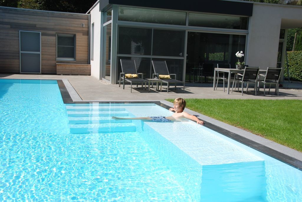 Zwembad van ideal pool nv project sint niklaas zwembadenplus